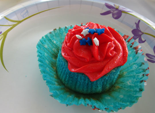 blue vanilla cupcake with red vanilla buttercream icing